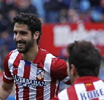 Raúl García celebrates his goal, Atlético's first, in their 3-0 La Liga win against Real Valladolid.